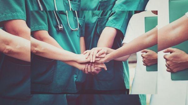 Bilde av flere sykepleiere som holder hender